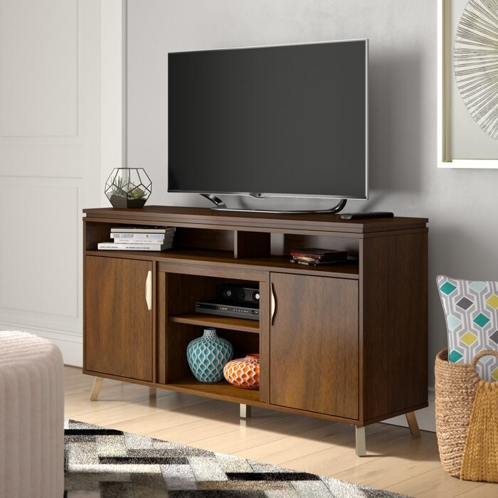 The wooden TV stand with silver legs
