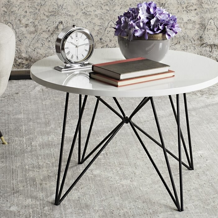 The coffee table with white top and black hairpin legs