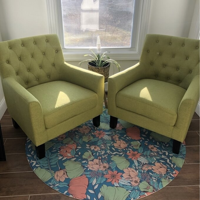Reviewer's picture of two green fabric arm chairs