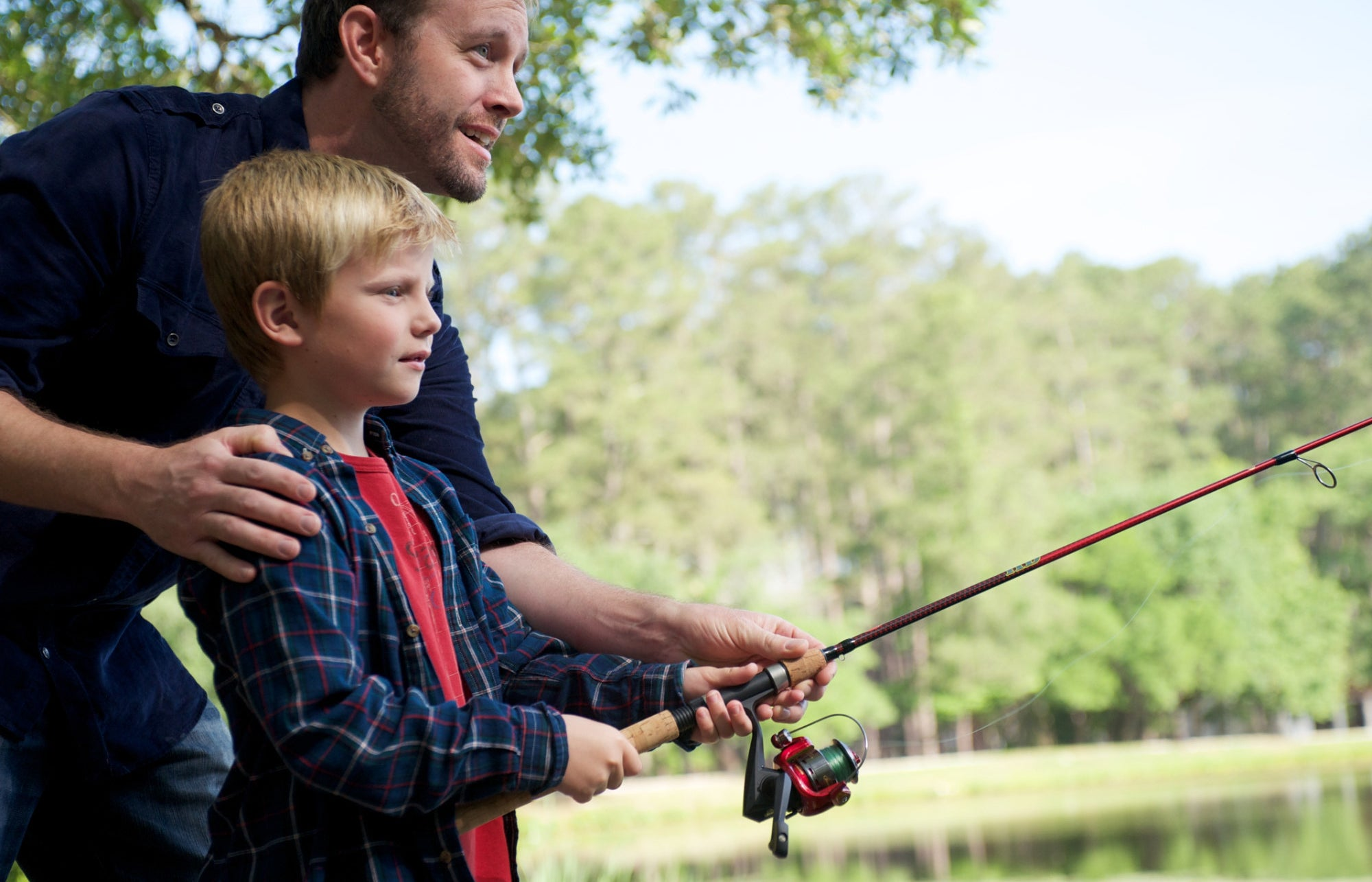 a father and son fishing at a lake