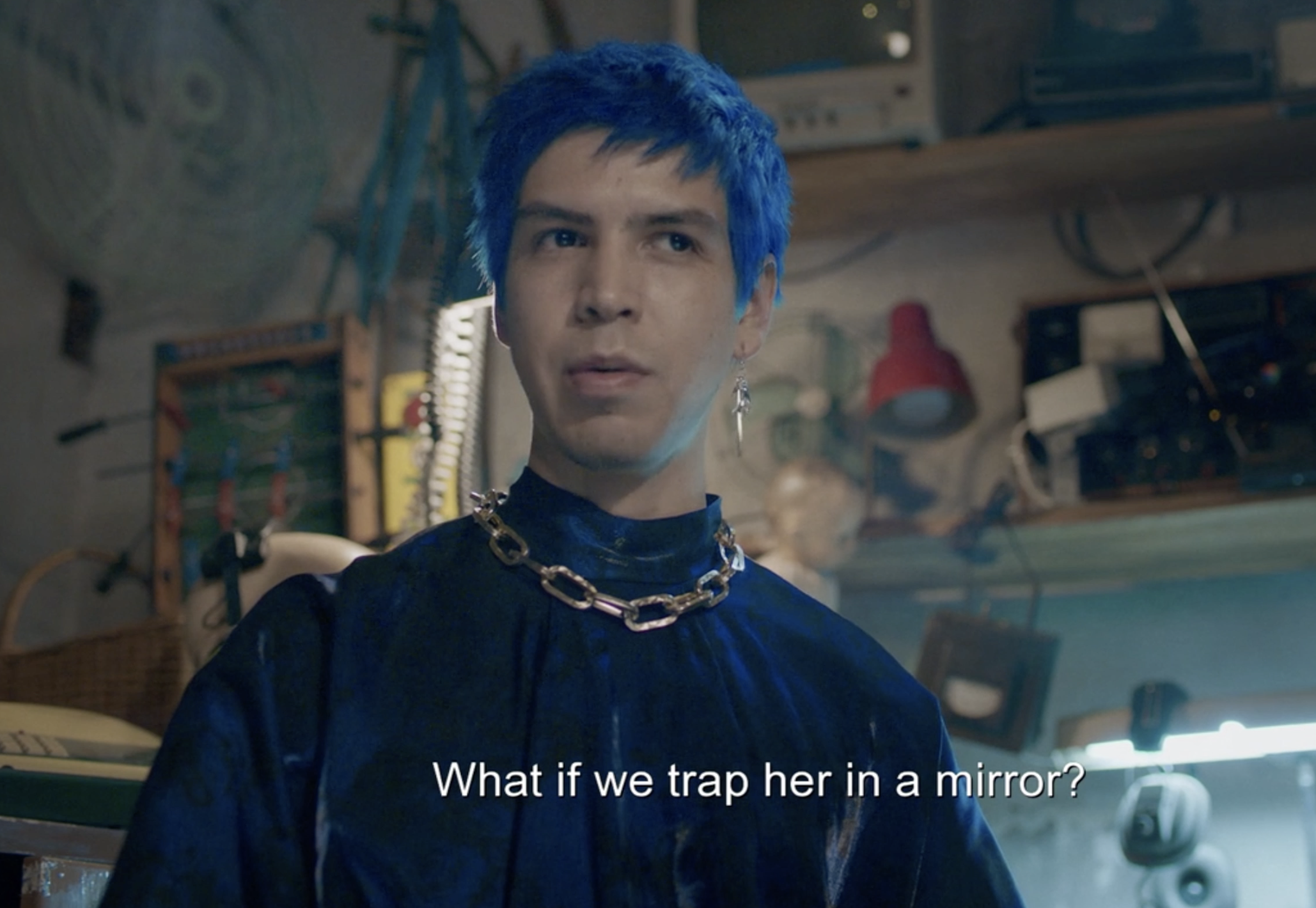 Andres in the blue long-sleeve shirt and chainlink choker
