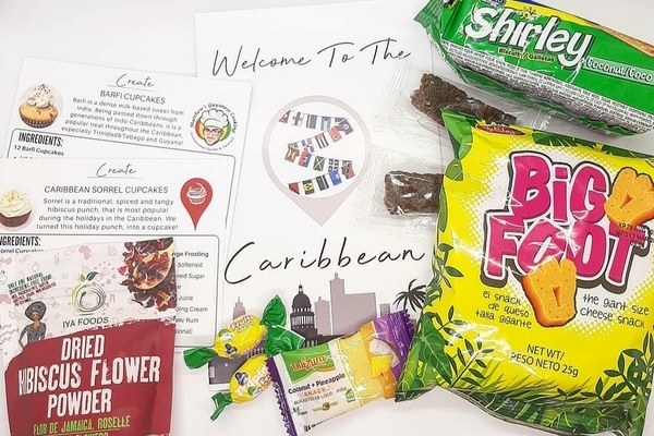A Culture Cakes Kit — the theme on the kit shown is Caribbean, and there are snacks, an info sheet, and a cupcake recipe