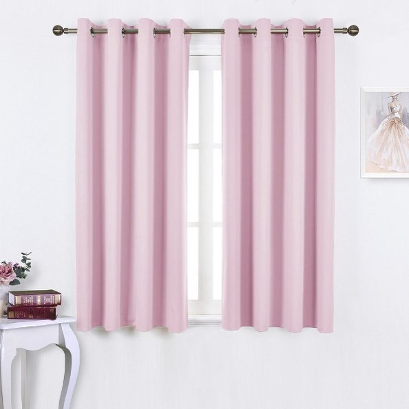 A set of short curtains framing a simple window