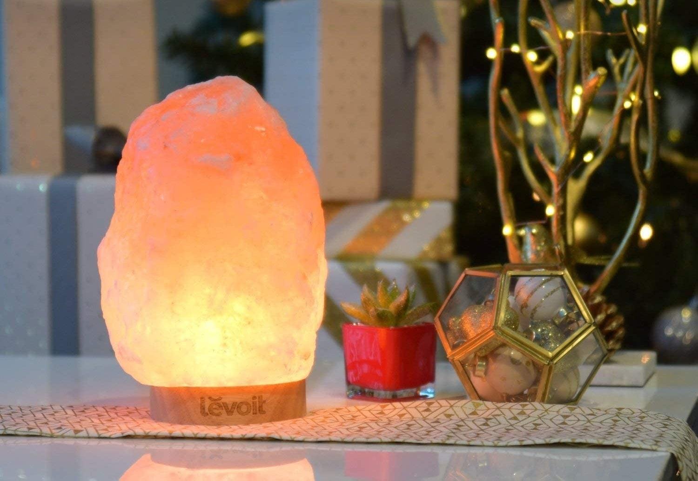 The lamp emitting an orange-pink glow
