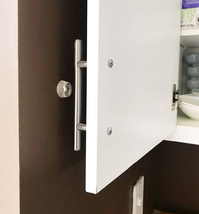 A door bumper protecting a wall from a cabinet door