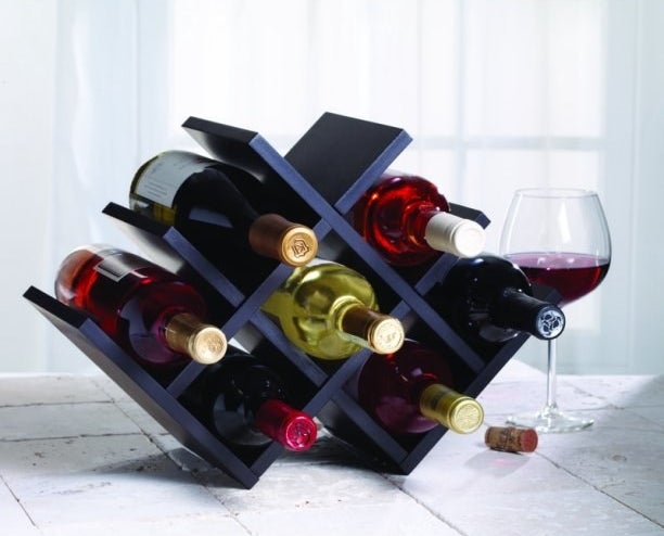 The wine rack filled with seven bottles