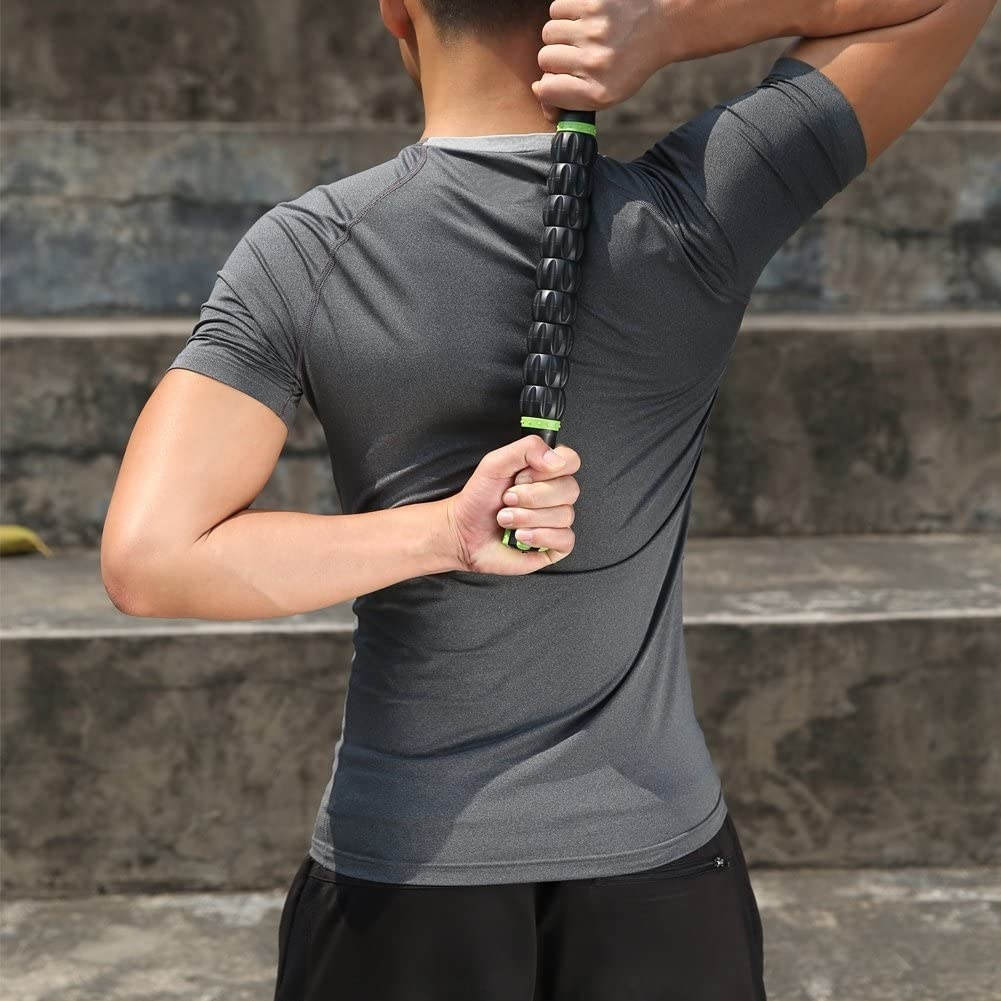 a model using the long beveled rolling stick on their back