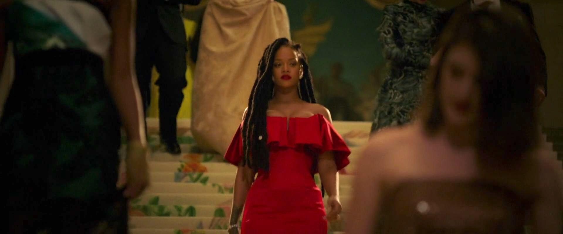 Rihanna walking down the stairs at the Met Gala in Ocean's 8