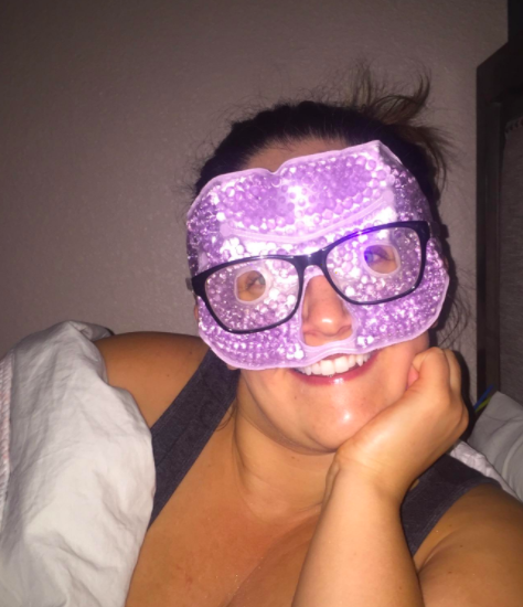A reviewer wearing the purple, gel bead-filled mask under their glasses