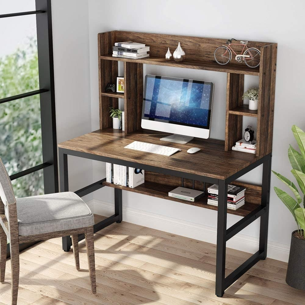 The Tribesigns Computer Desk with Hutch and Bookshelf being used as a computer desk
