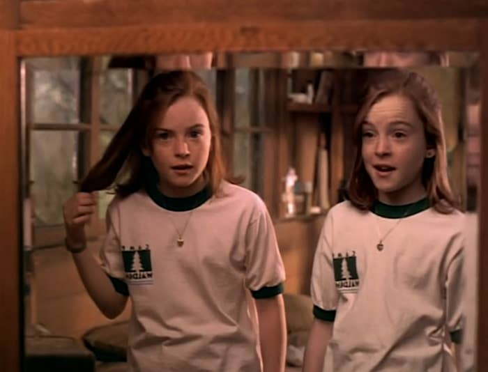 Lindsay Lohan as Hallie and Annie look at each other in the mirror
