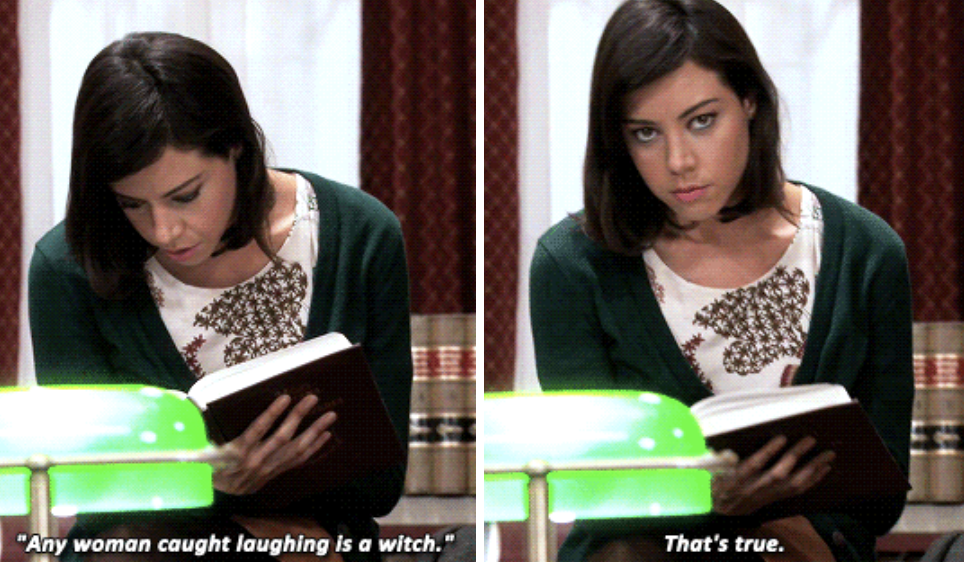 April reading an old Pawnee book, telling the camera that any woman who was caught laughing was a witch