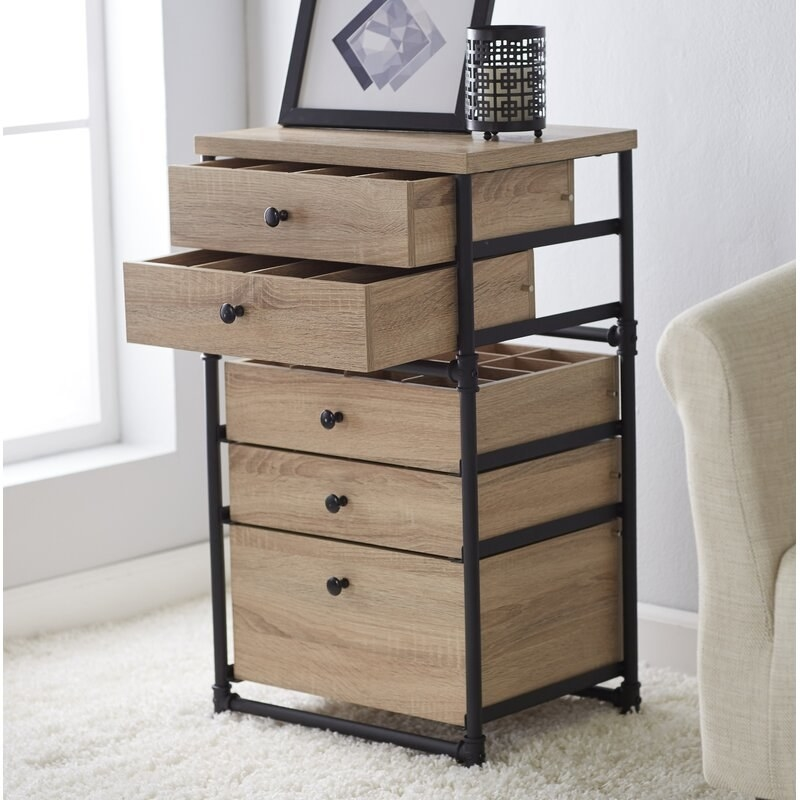 A chest of five light-wood drawers with built-in dividers in a black pipe frame