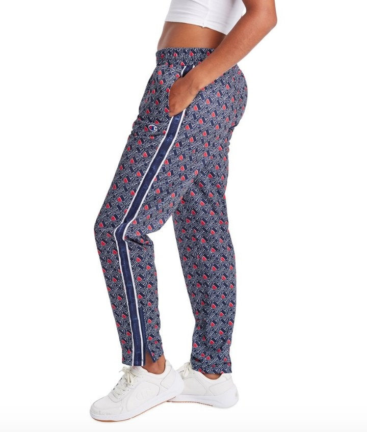 Model wearing blue patterned Champion logo pants