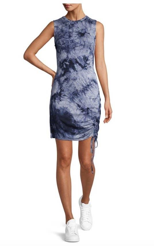 Model wearing blue tie dye mid thigh length dress