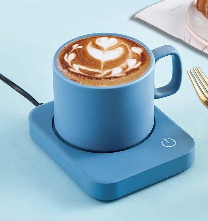 A mug of coffee on the electric mug warmer