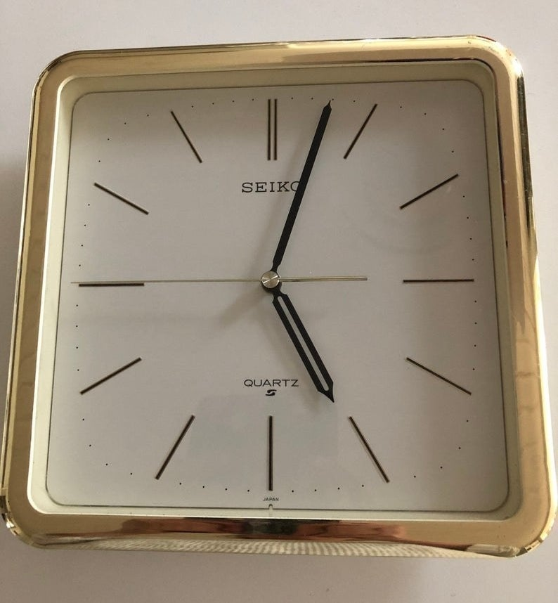 A brass and square Seiko wall clock that is from the '80s