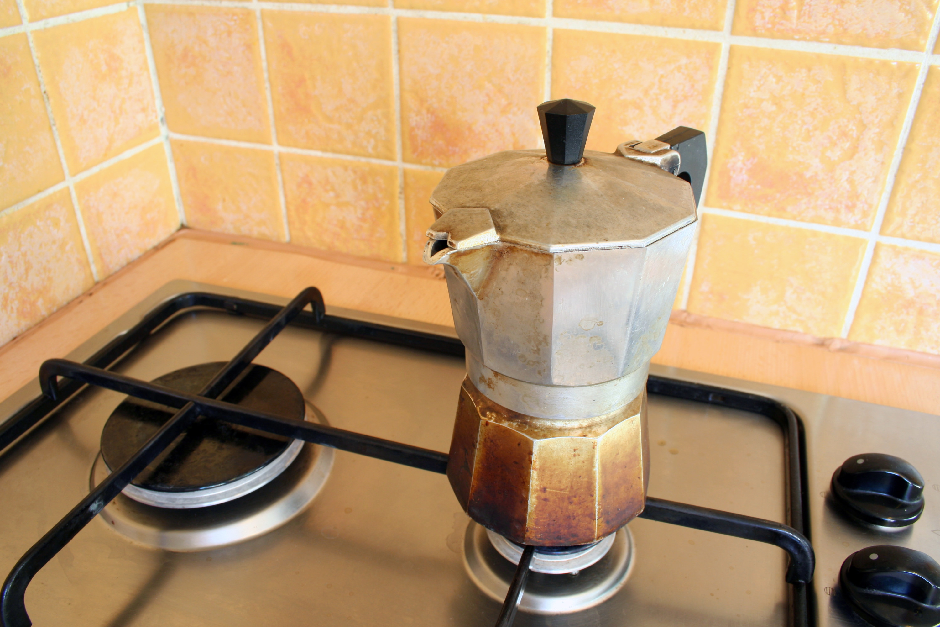 A stove-top espresso maker that had the bottom all burned at and the top is stained from use