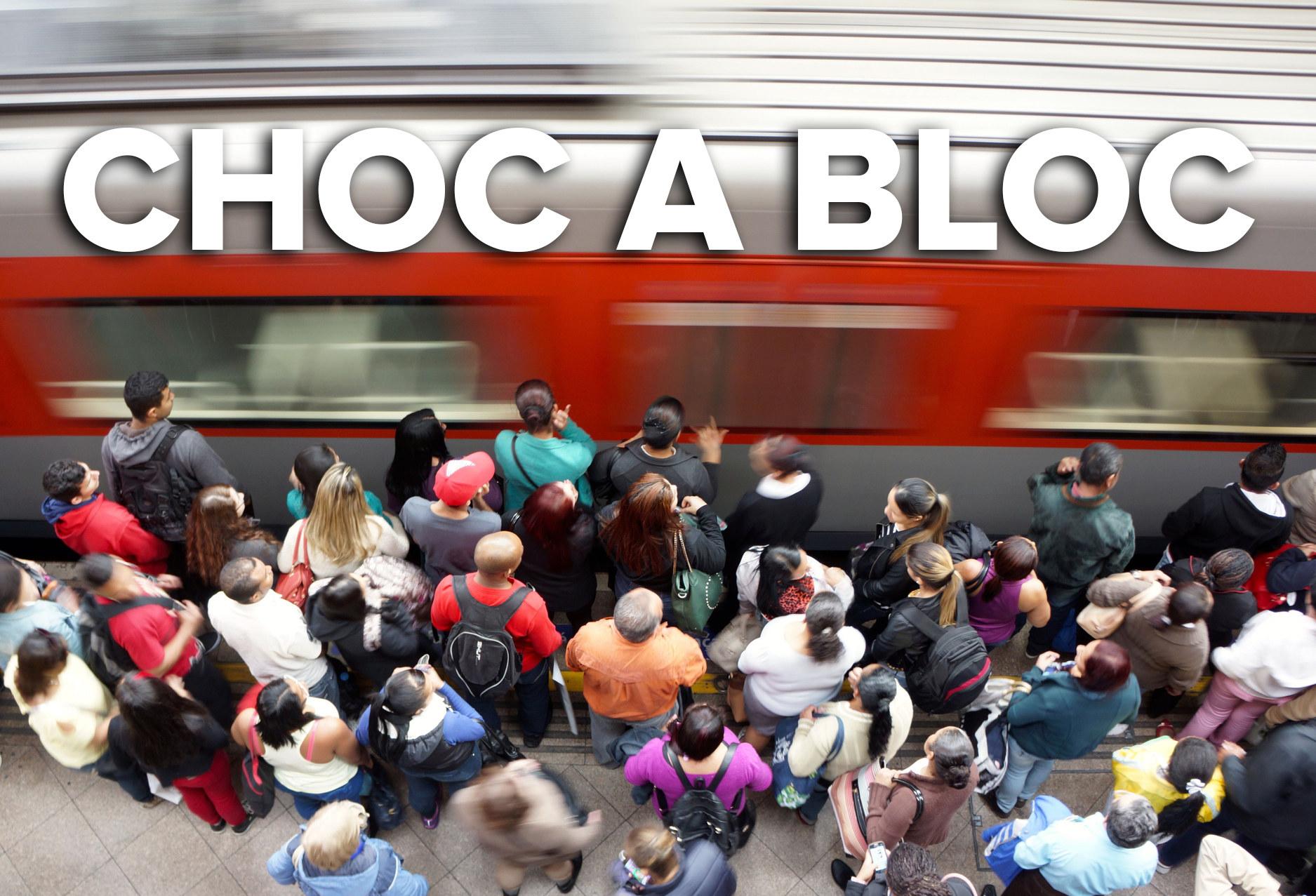 A crowded train station platform