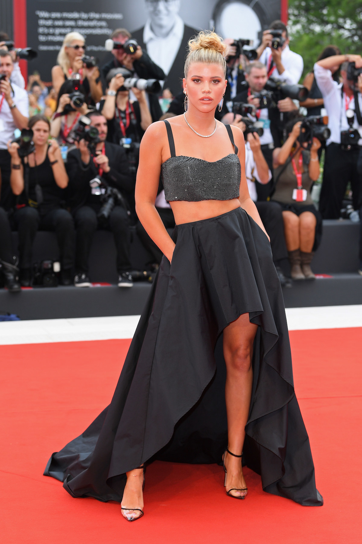 Sofia Richie walks the red carpet ahead of the Opening Ceremony.