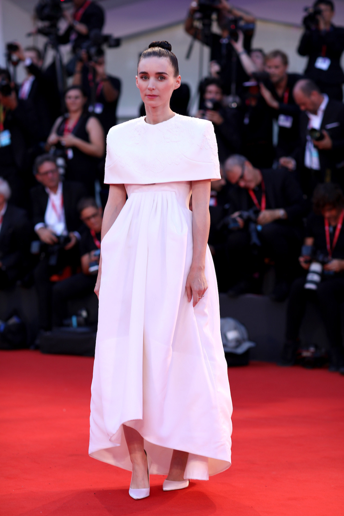 "Rooney Mara walks the red carpet ahead of the ""Joker"" screening."
