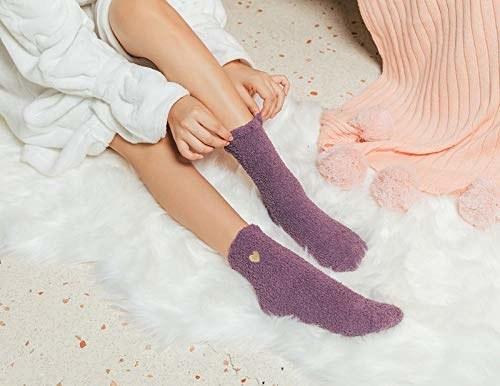 Person wearing purple fuzzy socks.