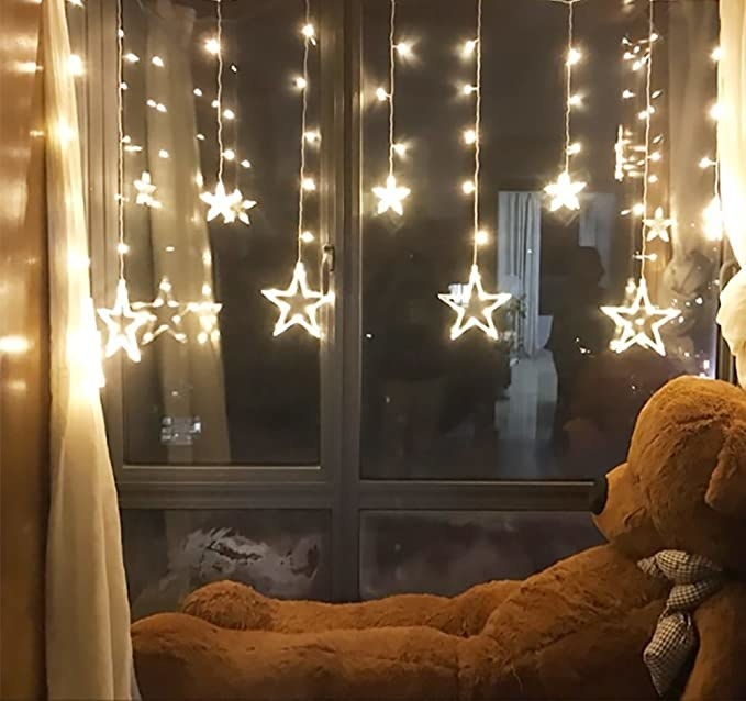 Star LED lights hung in a window.