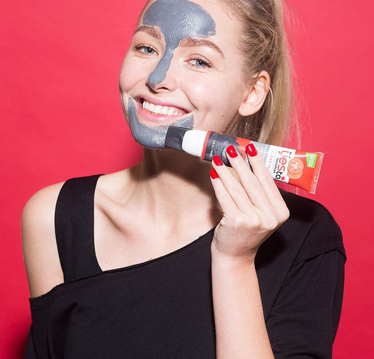 A person using the silicone tip to apply the product to their face