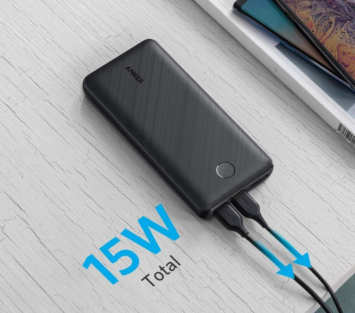 A power bank with two cords plugged in
