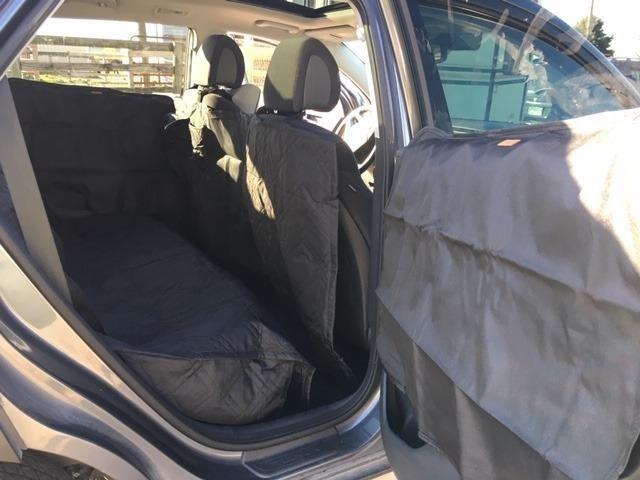Reviewer's photo of black door protector in car