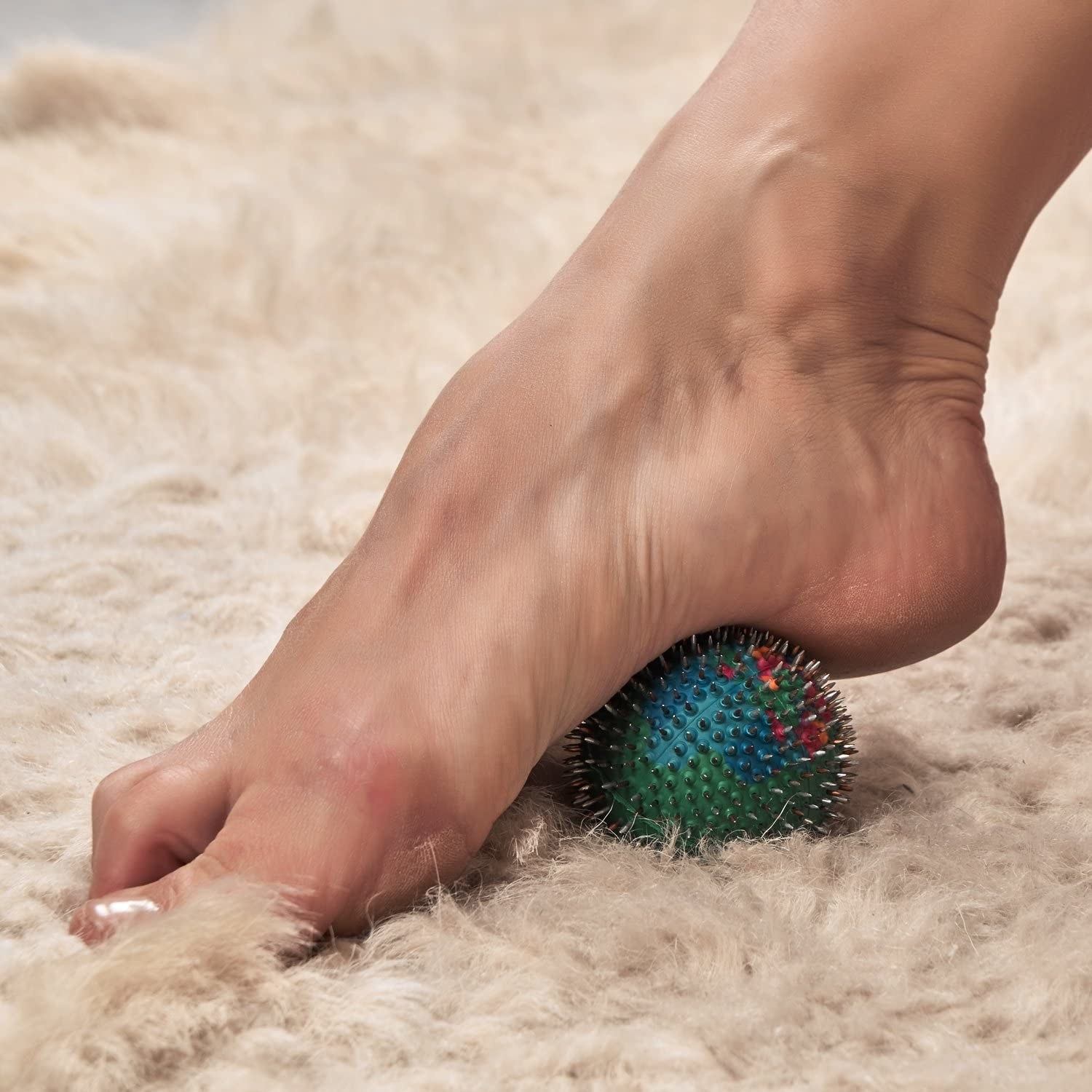 An acupuncture ball under a persons foot