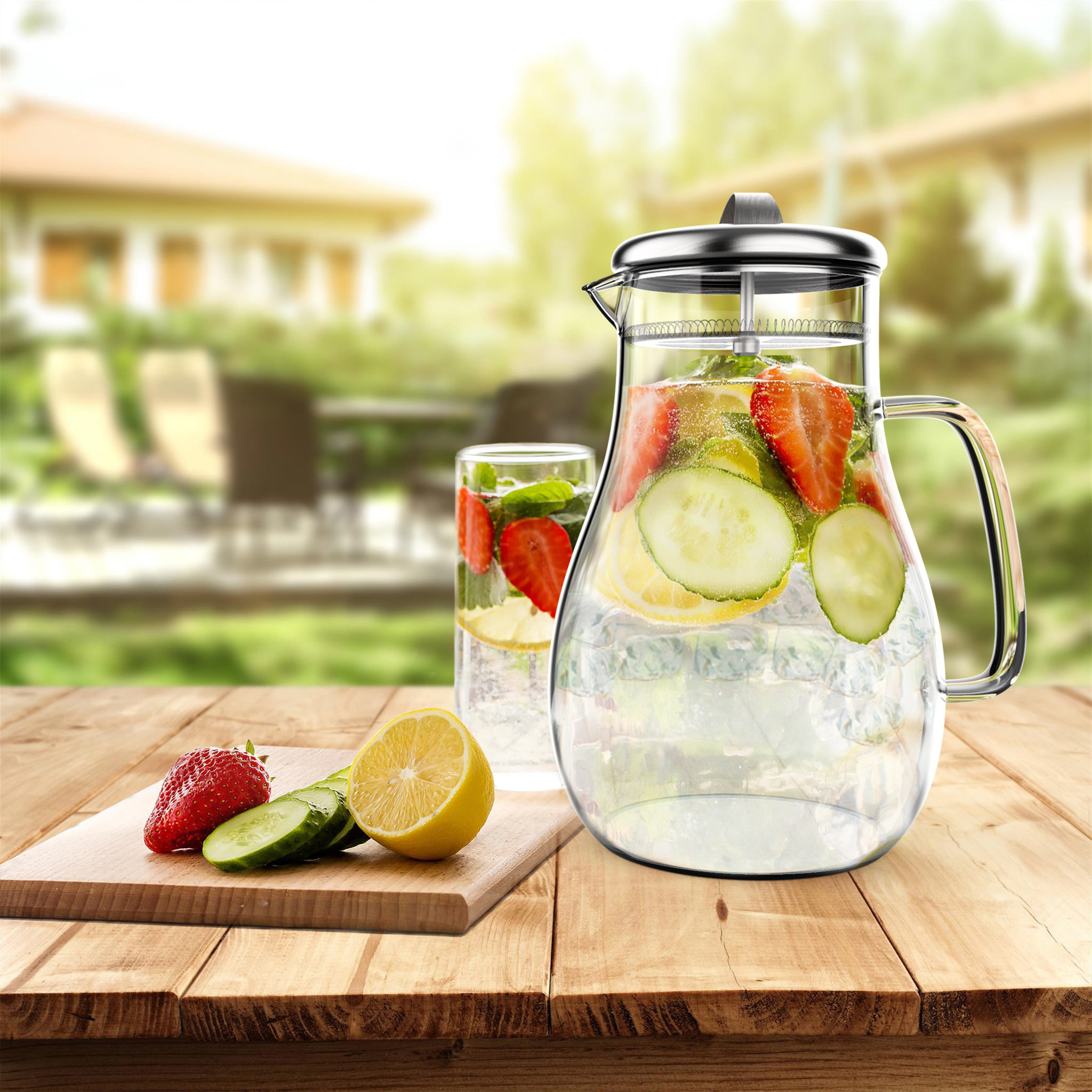 Clear glass pitcher with filter lid