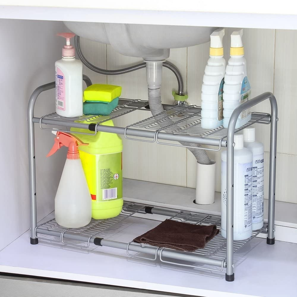 Cleaning supplies on the shelf under a sink