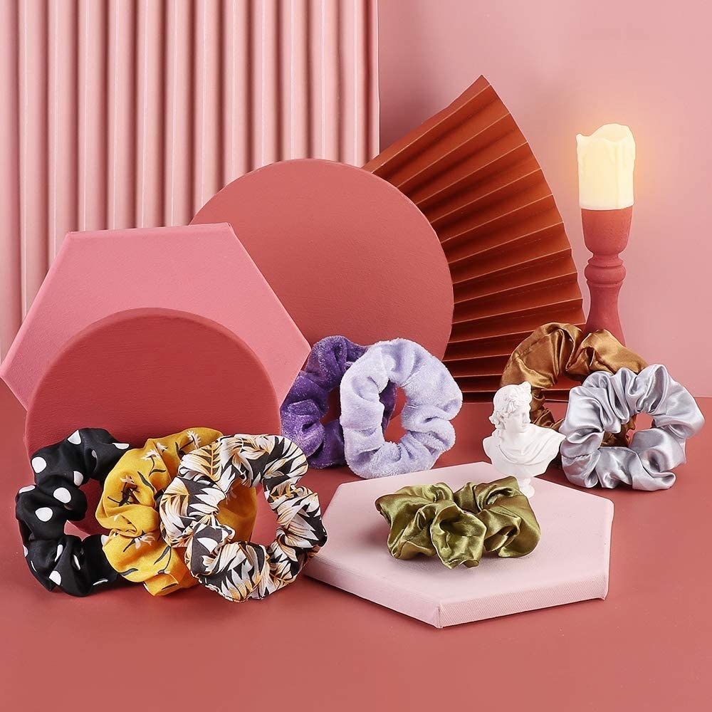Eight scrunchies on a sculptural display