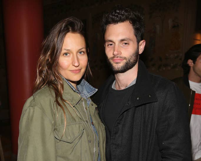 Domino Kirke and Penn Badgley posing at a Hollywood event
