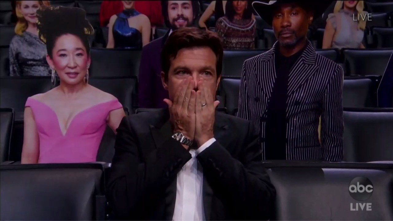 Jason Bateman touching his face