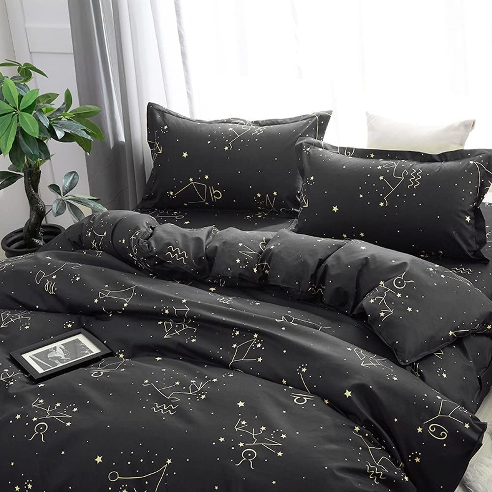 The zodiac comforter and bed pillow cases on a bed