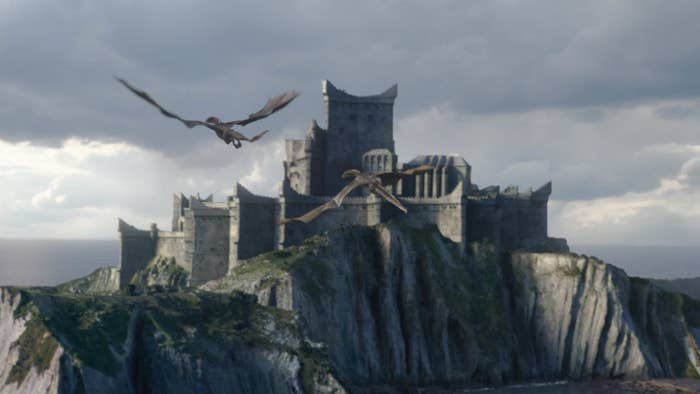 Still from Game of Thrones: Drogon flying back to one of the castles