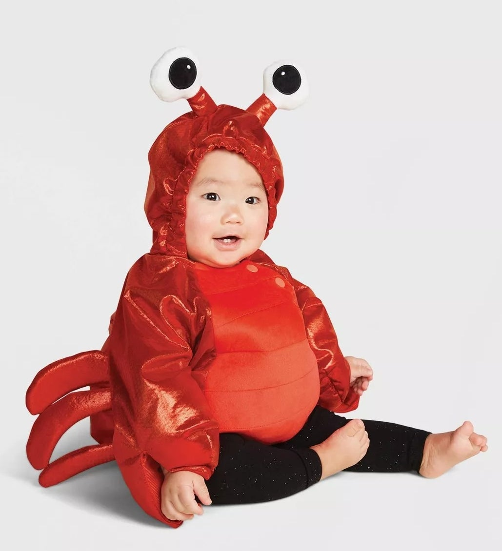 A red, long-sleeve lobster costume with a pair of eyes mounted on the hood