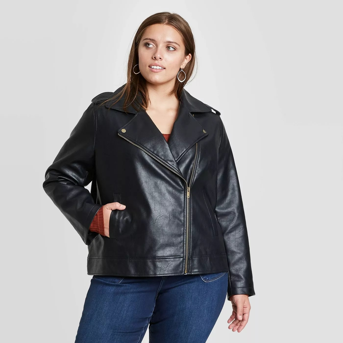 A model wearing a zipped up moto jacket