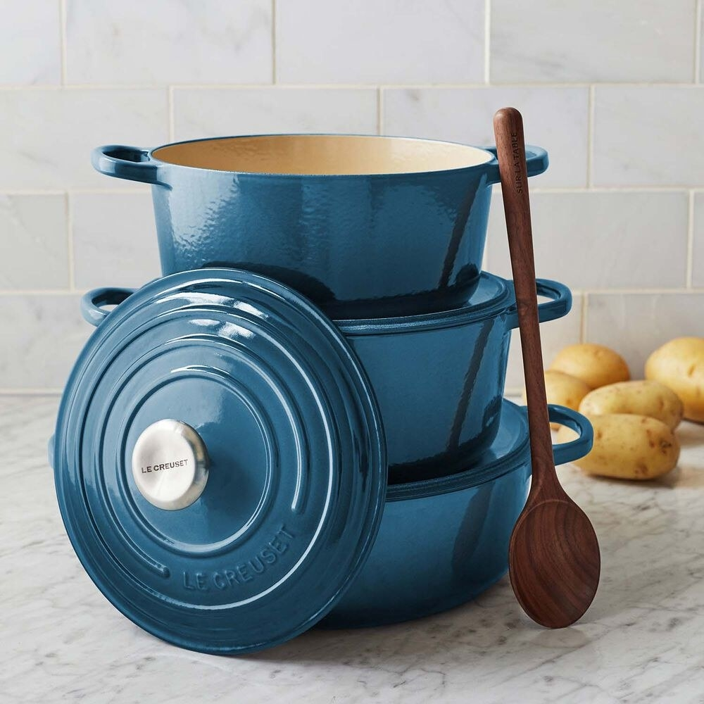 A stack of Dutch ovens in blue