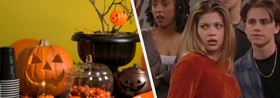 A table full of Halloween decorations is on the left with the cast of