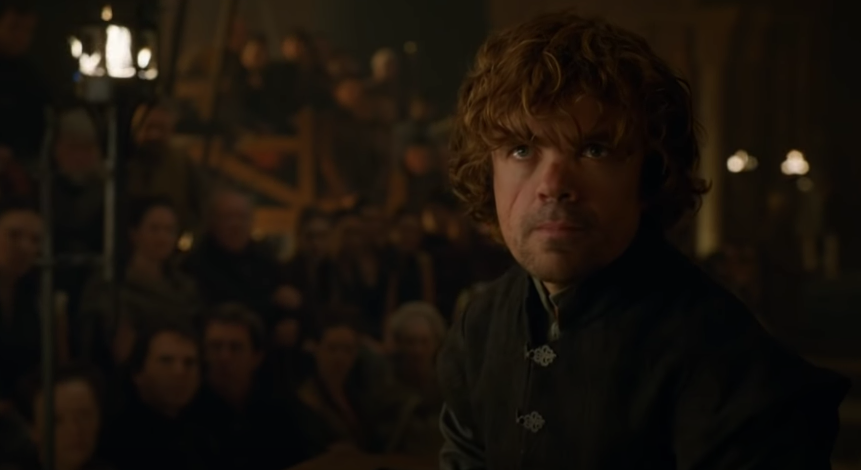 Still from Game of Thrones: Tyrion stands trial in a crowded thrown room