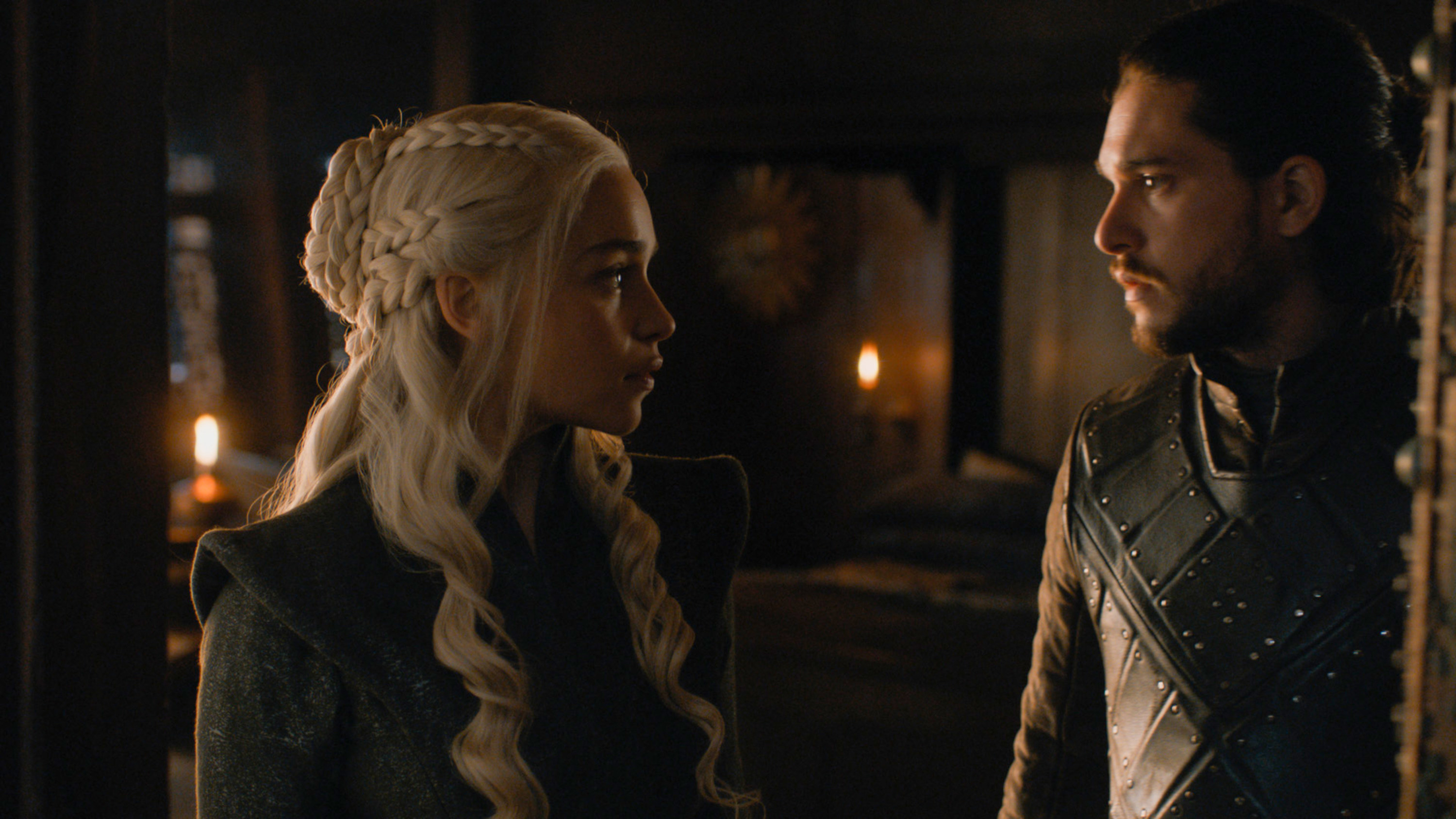 Still from Game of Thrones: Jon Snow and Daenerys look at each other at the entrance to her bed chambers