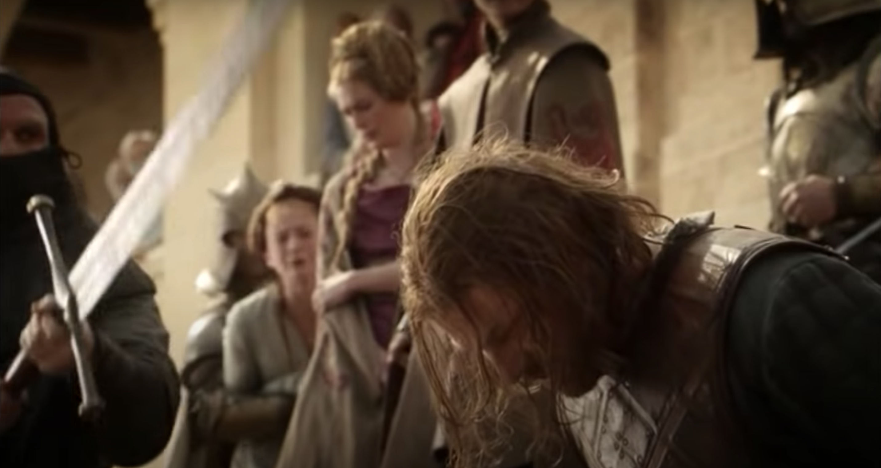 Still from Game of Thrones: Ned Stark kneels as an executioner swings a sword above his head; Joffrey looks on smiling, Cersei watches concerned and Sansa is screaming, being held back by a guard. A crowd watches from the castle in the background.
