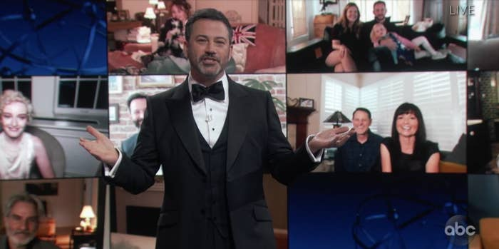 Jimmy Kimmel standing in front of some nominees on Zoom