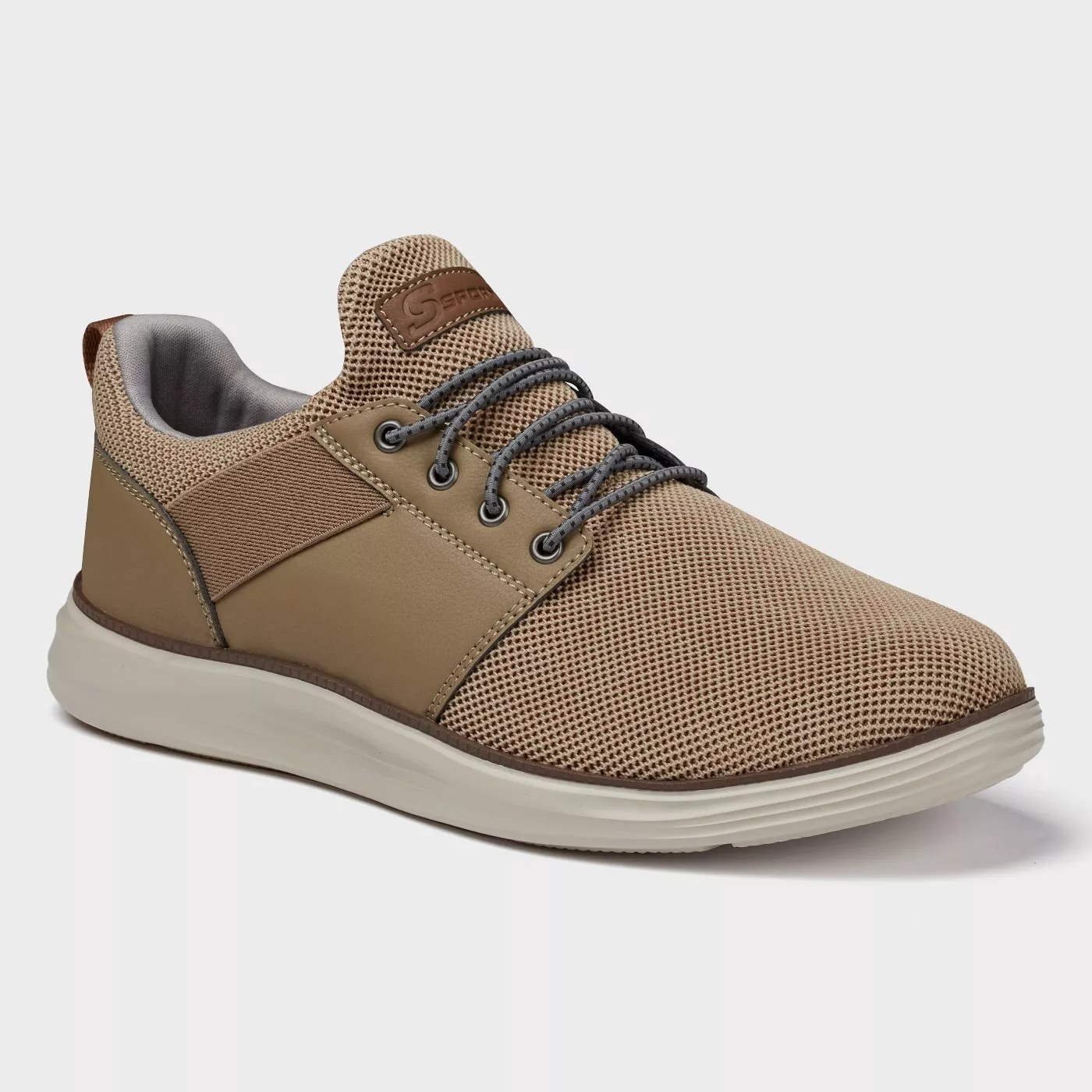 A taupe pair of sneakers with stretch laces
