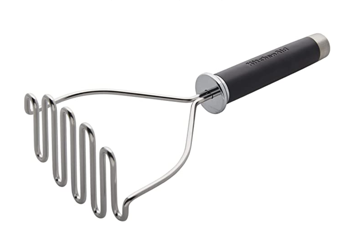 A stainless steel potato masher.