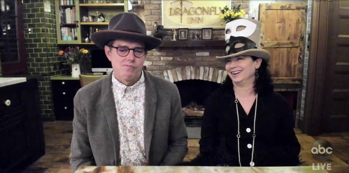 Daniel Palladino and Amy Sherman-Palladino at their home in front of a Dragonfly Inn sign