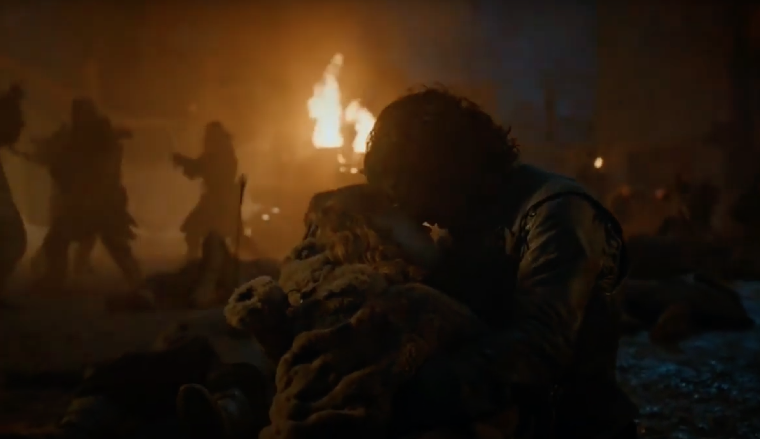 Still from Game of Thrones: Jon Snow cradles Ygritte's dead body in his arm as battle wages around him